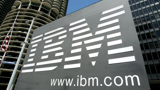 An IBM sign stands outside an IBM building in downtown Chicago, Illinois.