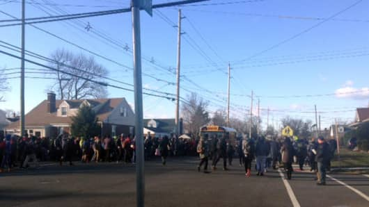 A school in Fair Lawn, NJ is evacuated Tuesday morning after a a mass shooting and bomb threat.