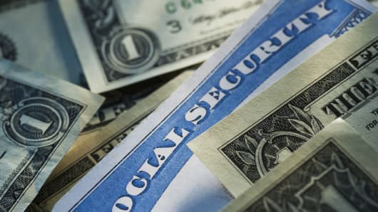 Social Security with dollar bills