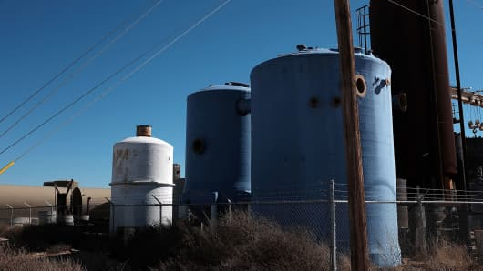 Unused tanks for the oil industry pile-up in a shop yard in the Permian Basin oil field on January 20, 2016 in the oil town of Andrews, Texas.