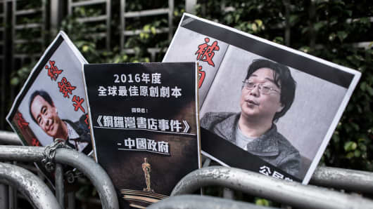 Placards showing missing booksellers Lee Bo (L) and Gui Minhai (R) in Hong Kong on January 19, 2016.