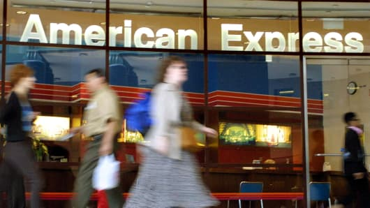 People walk in front of the American Express offices in New York City.