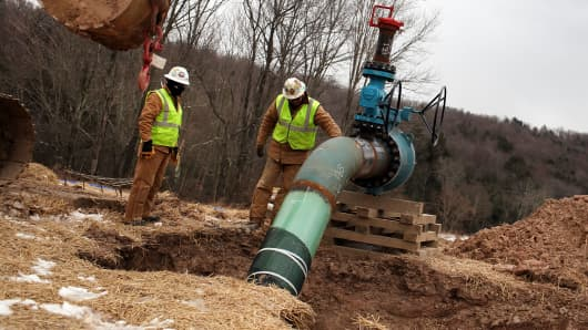 Men with Cabot Oil and Gas work on a natural gas valve at a hydraulic fracturing site in South Montrose, Pennsylvania.