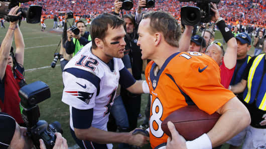 Tom Brady congratulates Peyton Manning after the Broncos defeated the Patriots during the AFC championship game on Jan. 19, 2014 in Denver.