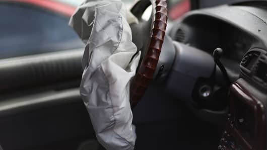 A deployed airbag is seen in a Chrysler vehicle at the LKQ Pick Your Part salvage yard on May 22, 2015 in Medley, Florida. The largest automotive recall in history centers around the defective Takata Corp. air bags that are found in millions of vehicles th
