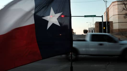 The Texas flag flies in downtown Sweetwater on January 19, 2016 in Sweetwater, Texas.