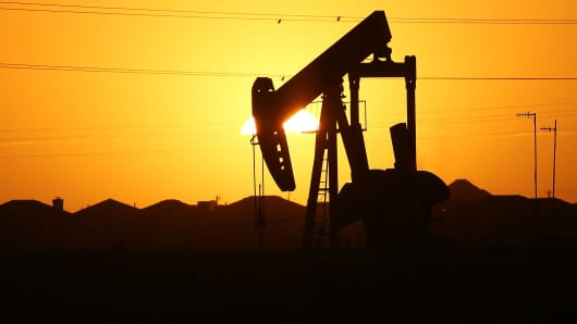 A pumpjack sits on the outskirts of town at dawn in the Permian Basin oil field on January 21, 2016 in the oil town of Midland, Texas.