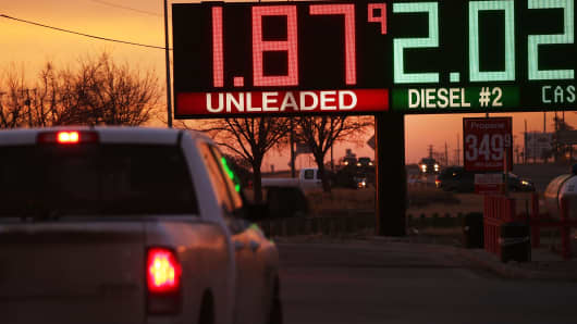 The price of gas is advertised at a fuel station in the Permian Basin oil field on January 20, 2016 in the oil town of Andrews, Texas.