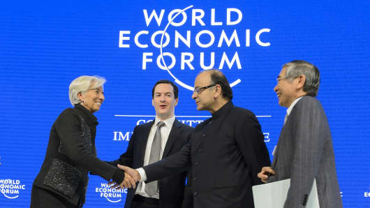 (From L) International Monetary Fund (IMF) Managing Director Christine Lagarde, British Finance Minister George Osborne, Indian Finance Minister Arun Jaitley and Governor of the Bank of Japan, Haruhiko Kuroda shake hands after a session of the World Economic Forum annual meeting on January 23, 2016.