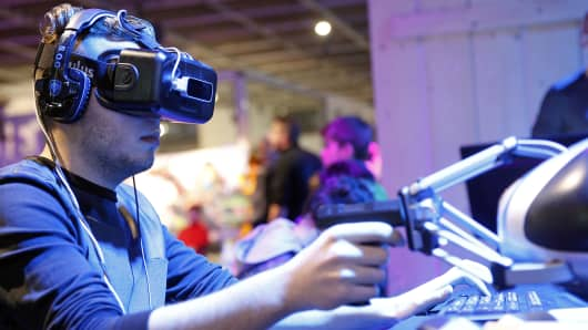 A gamer plays a game with the virtual reality head-mounted display 'Oculus Rift'