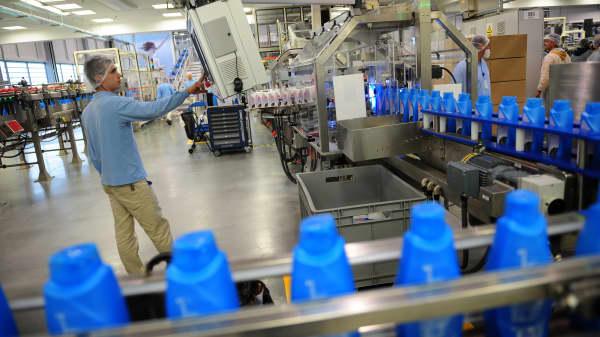 An employee surveys a production line at a Procter & Gamble plant.