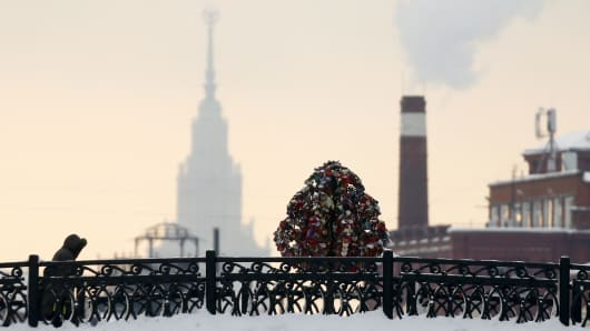 A pedestrian walks along a bridge in central Moscow, Russia, January 25, 2016.