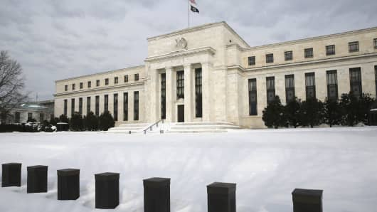 Snow covers the grounds of the U.S. Federal Reserve in Washington January 26, 2016.