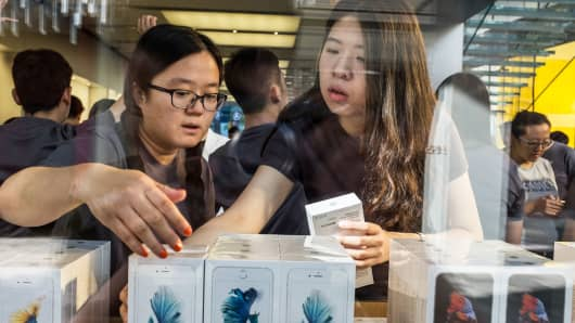 Customers purchase at an Apple store in Beijing, China.