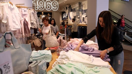 An employee folds clothes at a Gap store in San Francisco, Calif.