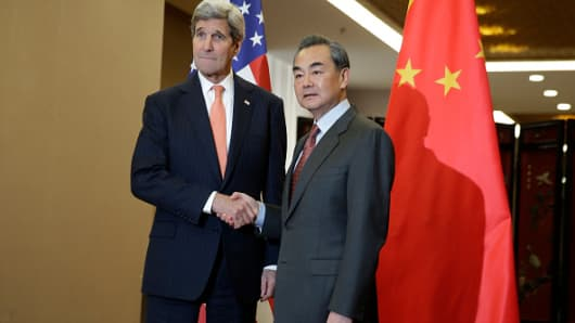 U.S. Secretary of State John Kerry and Chinese Foreign Minister Wang Yi shake hands before their bilateral meeting at the Ministry of Foreign Affairs January 27, 2016 in Beijing, China.