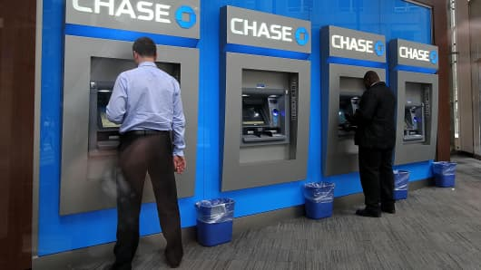 Bank customers use ATMs at a Chase Bank branch in New York City.