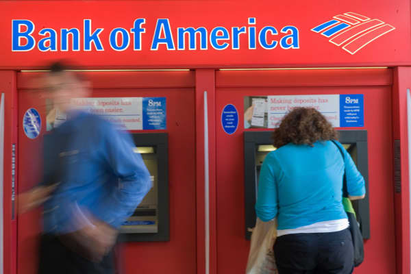 People use a Bank of America automated teller machine in Washington.