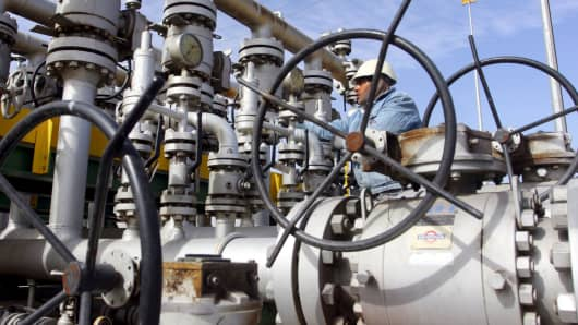 A worker checks the valves at Al-Sheiba oil refinery in the southern Iraq city of Basra.