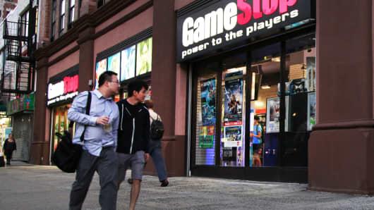 Pedestrians pass a GameStop store in New York.