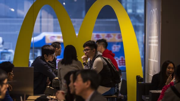 Customers dine inside a McDonald's Corp. Next concept restaurant in Hong Kong, China.