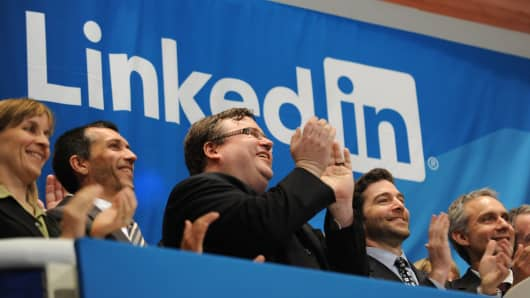 Linkedin founder Reid Garrett Hoffman (C) and CEO Jeff Weiner (2nd R) at the ringing of the opening bell of the New York Stock Exchange May 19, 2011