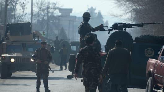 Afghan security personnel keep watch at the site of a suicide bombing at the home of a prominent politician in Jalalabad on Jan. 17, 2016.