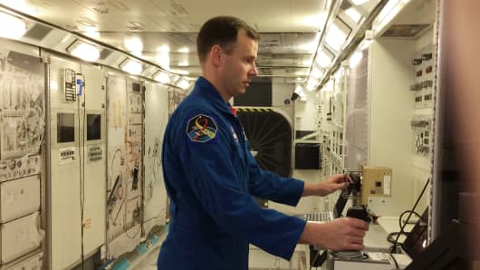 Astronaut Nick Hague at the International Space Station mockup and training facility.
