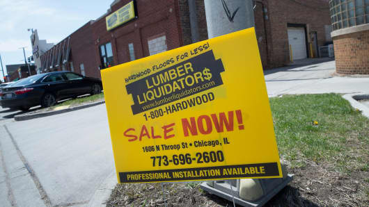 A sign advertising a sale sits outside a Lumber Liquidators store on April 29, 2015 in Chicago, Illinois.