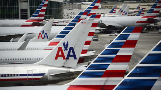 American Airlines passenger planes are seen on the tarmac at Miami International Airport.