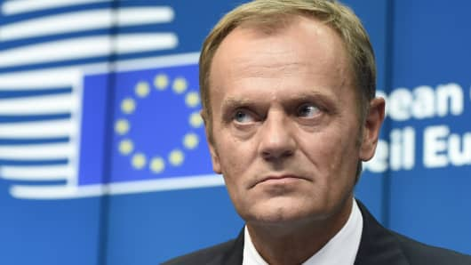 EU Council president-elect Donald Tusk attends a press briefing at the European Union summit.