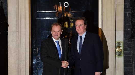 British Prime Minister David Cameron (R) greets European Council President Donald Tusk outside No 10 Downing Street in central London on January 31, 2016, ahead of their meeting.