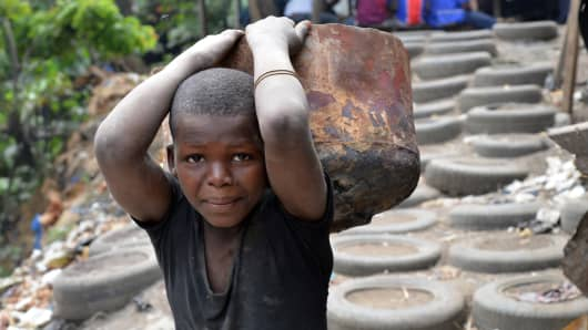 A child works in a forge in Abidjan, Ivory Coast.