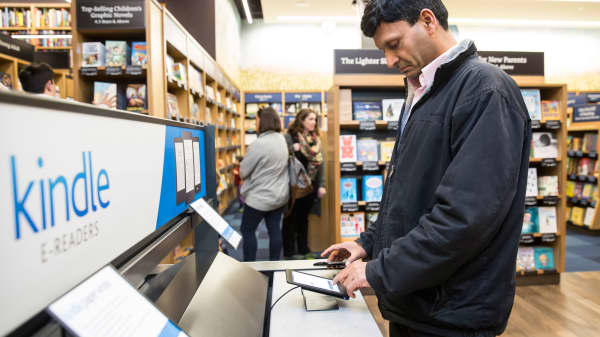A customer uses a Kindle table device at the Amazon Books store in Seattle, Washington.