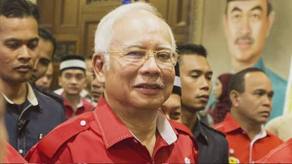 Malaysian PM Najib Razak's brother warns of 1MDB scandal fallout
