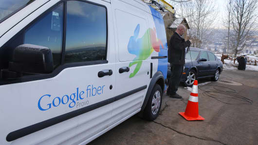 A technician gets cabling out of his truck to install Google Fiber.