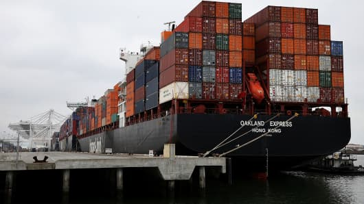 A container ship sits docked in a berth at the Port of Oakland.