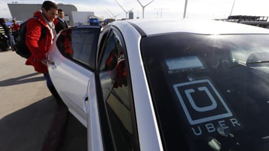 Uber driver picking up customer.