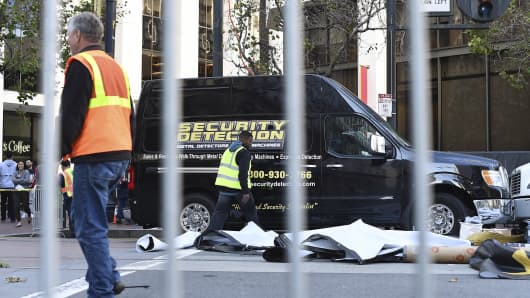 Workers pass a security company's truck at Super Bowl City in San Francisco, California.