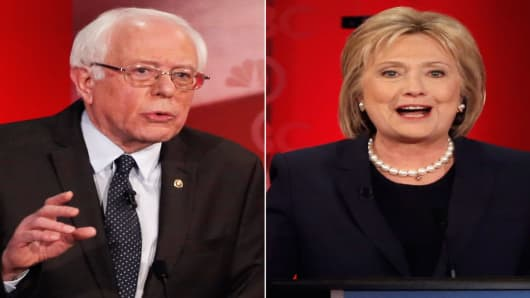 Democratic U.S. presidential candidates Senator Bernie Sanders (L) and former Secretary of State Hillary Clinton during the Democratic presidential candidates debate sponsored by MSNBC at the University of New Hampshire in Durham, New Hampshire, February 4, 2016.