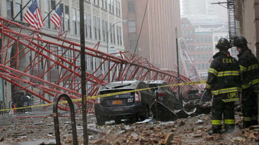 Emergency crews survey a massive construction crane collapse on a street in downtown Manhattan in New York February 5, 2016.