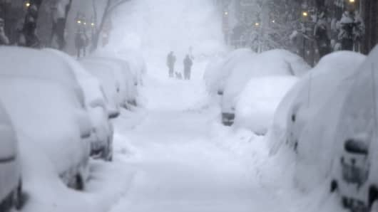 People chat on Monument Ave. during a Sunday morning blizzard in Charlestown, Boston on February 15, 2015.