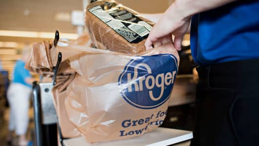 An employee bags a customer's purchases at a Kroger store in Peoria, Illinois.