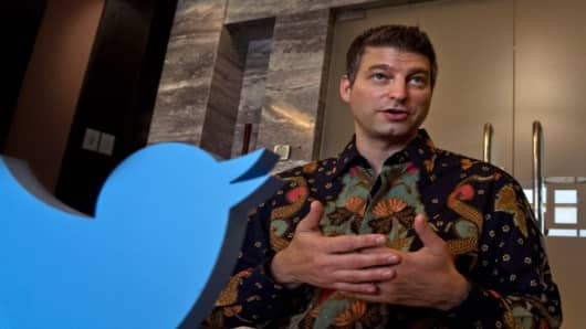 Twitter president of global revenue and partnership Adam Bain speaks at a press conference in Jakarta on August 29, 2014.