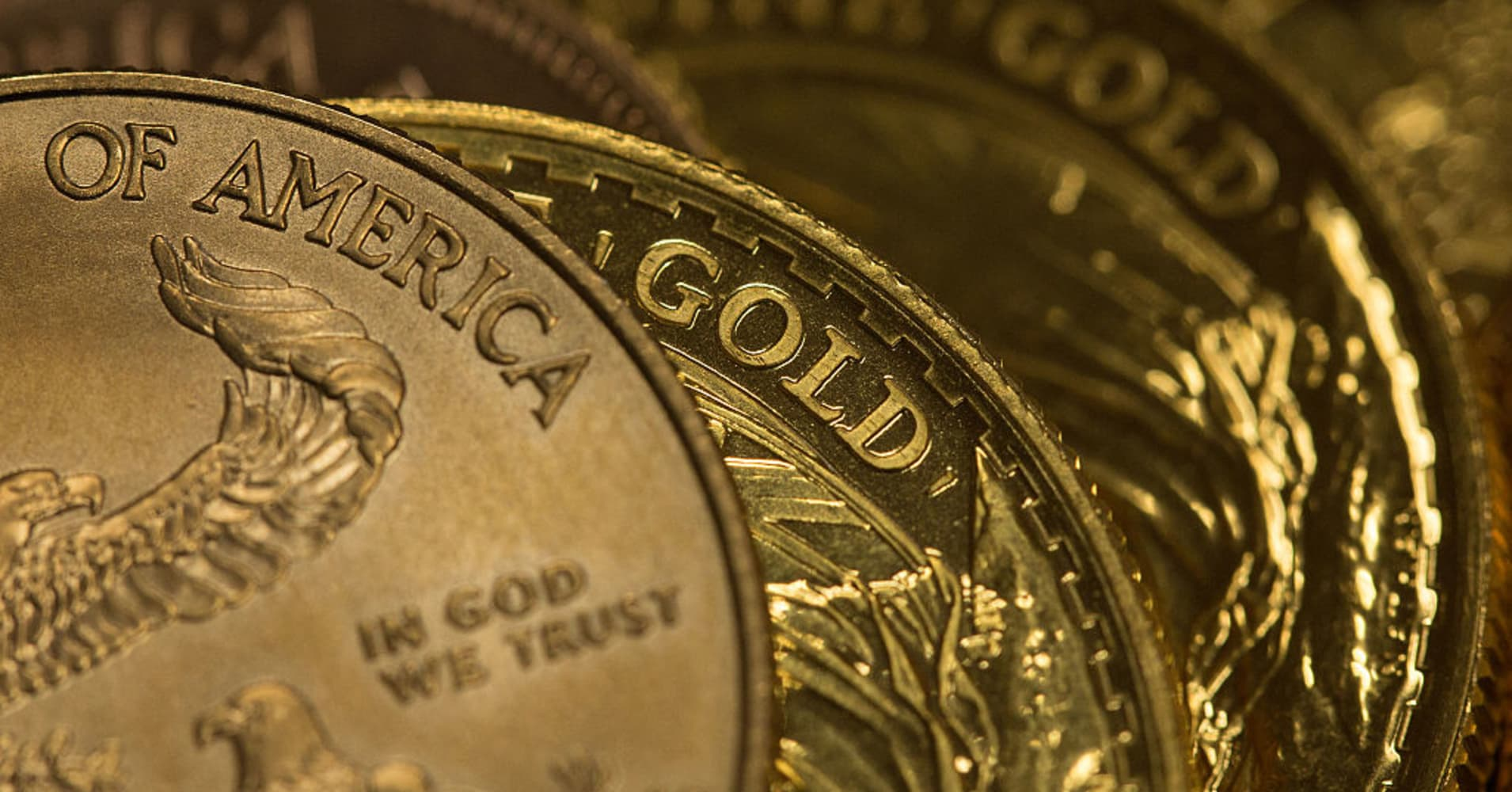 Gold nudges down as strong US data boosts rate rise view