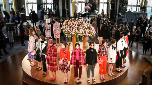 Models pose during the Kate Spade presentation at the Rainbow Room in New York on Feb. 12, 2016.