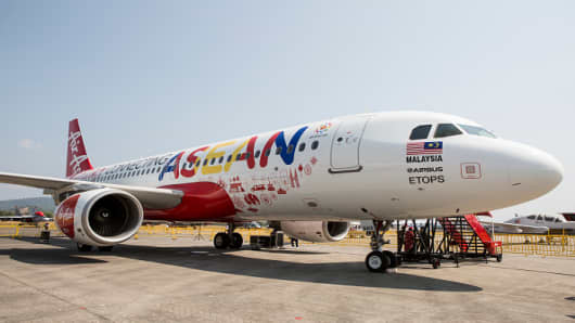 An Airbus Group NV A320 aircraft operated by AirAsia Bhd. stands on the tarmac before its unveiling at the Langkawi International Maritime and Aerospace Exhibition in Langkawi, Malaysia, on Wednesday, March 18, 2015.