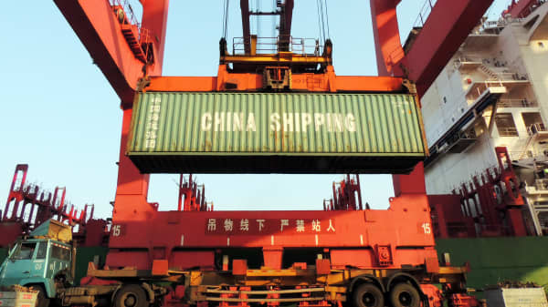 Containers are transported at a port in Lianyungang, eastern China's Jiangsu province.