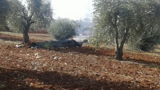 ALEPPO, SYRIA - FEBRUARY 15: A sea launched ballistic missile is seen unexploded on the soil at a olive grove after Russian warships, anchored near Latakia Port, launched 8 ballistic missiles in Azaz District of Aleppo, Syria on February 15, 2016.