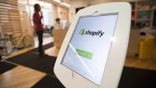 An Apple iPad with the Shopify app is displayed at the entrance to the company's headquarters in Toronto, Ontario.